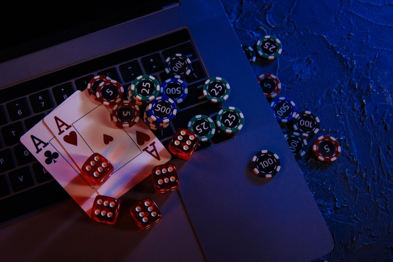 casino-play-online-concept-playing-chips-cards-dices-laptop-s-keyboard-min